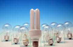 Energy-efficient vs normal light bulbs Stock Photos