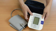 Nurse hands put pressure check tool to bag. Stock Footage
