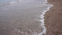 tides and waves at beach - stock footage