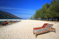 two bench or deckchair on beach at koh lipe - stock photo
