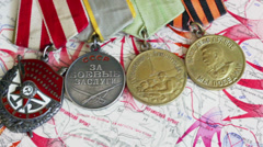 Soviet military medals of the World War II on a battle operations map Stock Footage