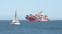 Sailboat and Container Ship In Harbor Stock Footage