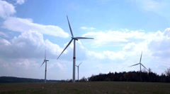 Power plant made of few wind turbines on a central european hill Stock Footage