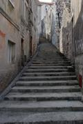 Old stone stairs on the street in Dalmatia, Croatia. Stock Photos