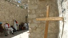 4K UHD Christian Pilgrims visit Via Dolorosa cross in Old City Jerusalem Stock Footage