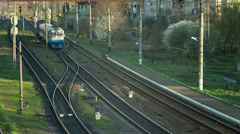 Crossing of a set railroad tracks near the station Stock Footage