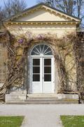 garden house with wisteria - stock photo