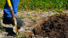 Man digs the ground side view Stock Footage
