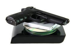 database with pistol - stock photo