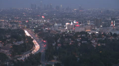 Aerial view Los Angeles panorama downtown skyscraper traffic car freeway highway Stock Footage