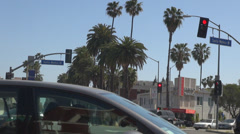 Car wait traffic red light intersection avenue Santa Monica blvd Los Angeles LA  Stock Footage