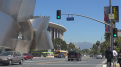 Walt Disney Concert Hall traffic car street people crossroad iconic building USA Stock Footage