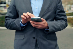 Businessman hands texting on smartphone in the city NTSC - stock footage