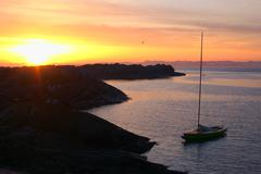 sailing boat anchoring at the norwegian coast - stock photo