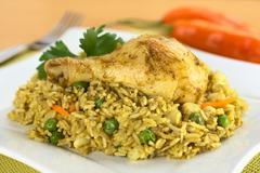 peruvian dish called arroz con pollo - stock photo