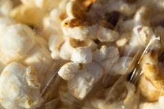 Popcorn package. macro Stock Photos