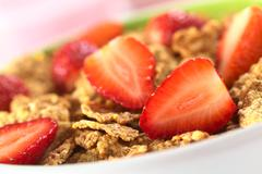 wholewheat flakes with fresh strawberries - stock photo