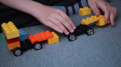 Child's hands playing with a construction toy set, smart kid, plastic bricks Stock Footage