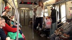 Modern b-boys dancing in a NYC subway car. - stock footage