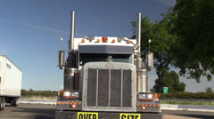 Big rig semi trucks, interstate 5, potato harvester Stock Footage