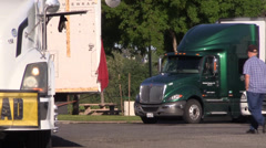 Big rig semi trucks, interstate 5 ,driver walking Stock Footage