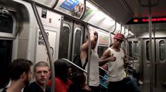 Modern b-boys  in a NYC subway car. - stock footage