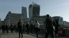 Stock Video Footage of Large crowd of pedestrians walk over London Bridge 37. HD version