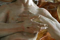 Statue of Jesus with crossed hands Stock Photos