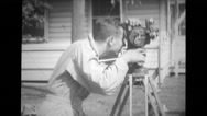 A young man filming with a camera Stock Footage