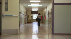 Kids Running Down Hall - stock footage