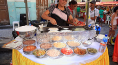 Local prepares tapioca at the local market in the downtown of Recife, Brazil Stock Footage