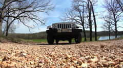 White 2014  Jeep driving over camera Stock Footage