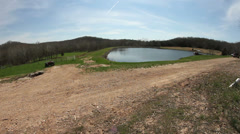 Slider wide angle shot of scenic lake / pond area Stock Footage