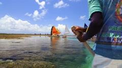 Jangada cross the Barrier reef in Porto de Galinhas, Pernambuco in Brazil - stock footage