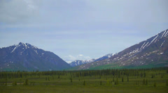 Pan Right, Mountain Range with Green Field 3 Stock Footage