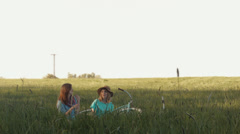 Two Friends Picnic Together, Beautiful Background View Of Farm Land Stock Footage