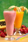 Strawberry milkshake and papaya juice Stock Photos