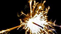 Sparkler over black (hd). gun powder sparks shot against deep dark background Stock Footage