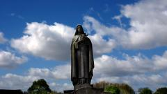 Graveyard. Cemetery. Time-lapse. Virgin Mary Statue Stock Footage
