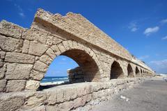 Ancient Roman aqueduct at Caesarea - stock photo