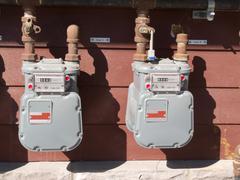 Exterior wall natural gas consumption meters Stock Photos
