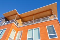 Bright timber clad condo building exterior detail Stock Photos