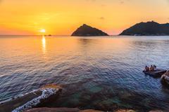 Tourism watching beautiful sea with sunset scene Stock Photos