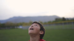 Boy practices heading a soccer ball - stock footage