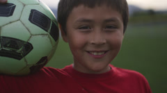 Boy with soccer ball smiling - stock footage