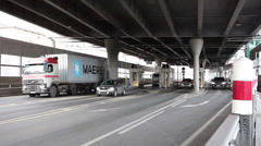 Vehicles stopping before fee booth in entrance of motorway, Russia Stock Footage