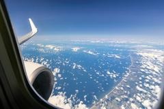 Beautiful cloud sky view from aeroplane window Stock Photos