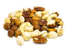 heap of assorted nuts . - stock photo