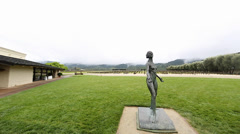 dolly shot - outside robert mondavi statue - stock footage