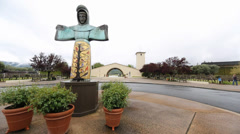 dolly shot - in front of robery mondavi statue - stock footage